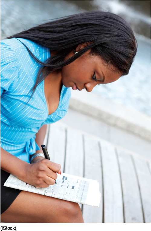 Photo of a woman filling out a form.