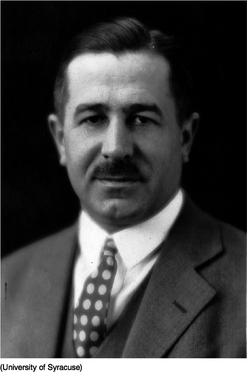 Photo of Floyd Allport. He has a gentle expression on his face, is wearing a dark suit with a polka dot tie, and has a mustache.
