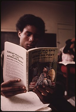 256px-BLACK_STUDENT_IN_A_BLACK_STUDIES_CLASS_IN_A_WEST_SIDE_CHICAGO_CLASSROOM_READING_A_BOOK_ABOUT_GREAT_RULERS_IN_AFRICA'S..._-_NARA_-_556263.jpg