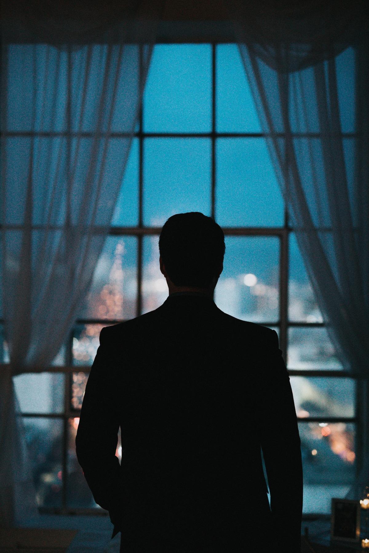 Man at Window Silouhette.jpg